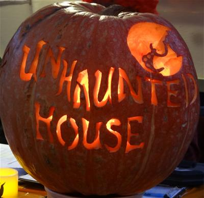 Pumpkin carved to say Unhaunted House
